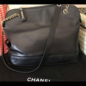 Black top zip Chanel bag